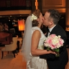 Bride and Groom Kiss in Lobby after First Look in Carlton Hotel Lobby
