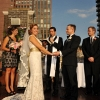 Bride looks out at Guests during Rooftop Ceremony
