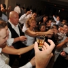 Groom doing Shots with Guests