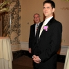 Groom watching Bride walk down Aisle